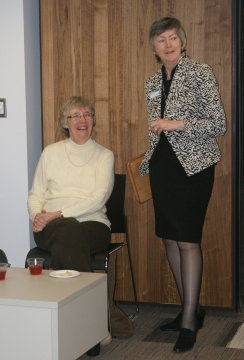 Library CEO Sonia Lewis (right) chats with a volunteer.