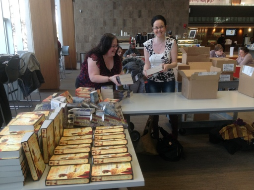 WordsWorth Books sets up their sales table.
