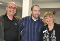 Paul Preston from IT services and Gary Bauman, webmaster, with Ann