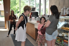 Premier Wynne chats with a couple of surprised customers at Hacienda Coffee.
