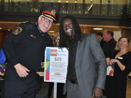 Police chief Bryan Larkin and a guest