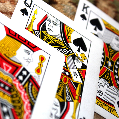 Three playing cards that show the Jack, Queen, and King of Diamonds.