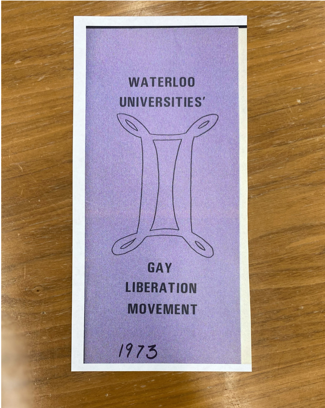 Photo of cover of a pamphlet produced by the Waterloo Universities' Gay Liberation Movement in 1973
