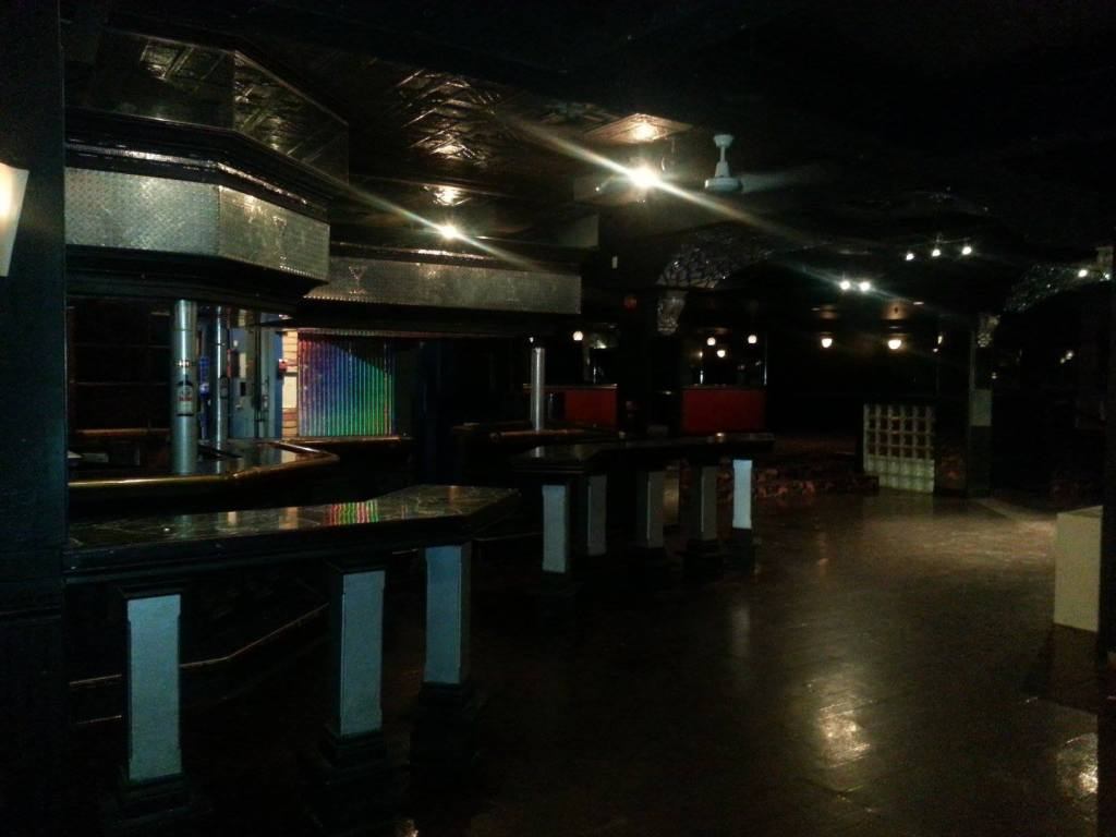 A photo inside Club Renaissance after it closed for business in 2013. The bar, tables, lounge, DJ booth and dancefloor are visible.